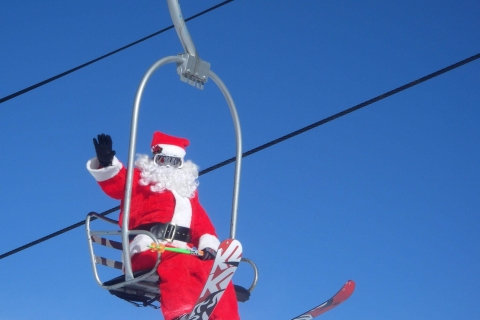 Santa rides the chairlift at Loveland Ski Area.