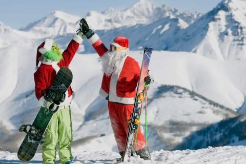 Santa and the Grinch high-fiving at Crested Butte.