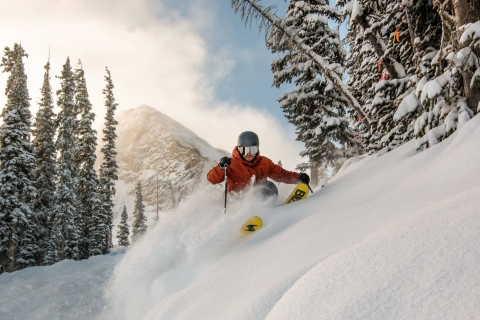 Skier in powder at Crested Butte Mountain Resort.