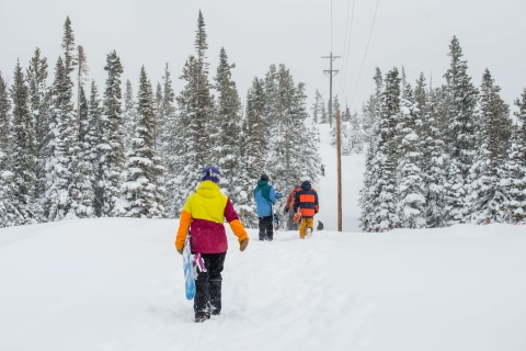 Skiers walking to the lift at Monarch mountain.