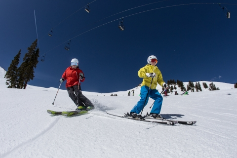 Two skiers at Arapahoe Basin.