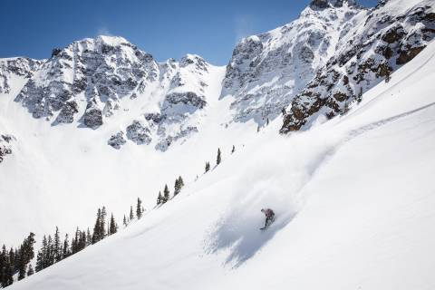 A skier on a steep run at Silverton.