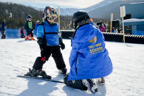 A child's lesson on ski boots at Winter Park Resort.