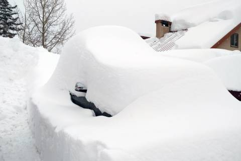 Car covered in snow at Purgatory
