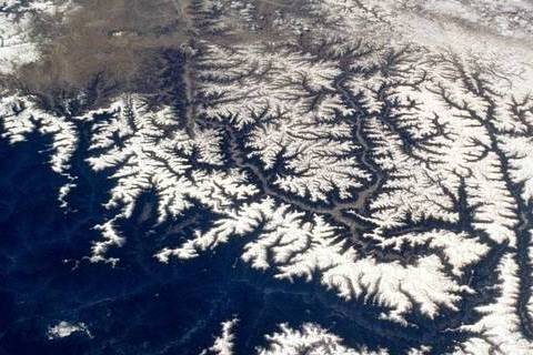 Snow caps the line of the Himalayas in this 70mm frame photographed by a space shuttle using a handheld 70mm camera.  Credit: NASA