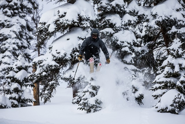 Blasting out of the trees and into the goods. Photo by Dave Camara from Arapahoe Basin.