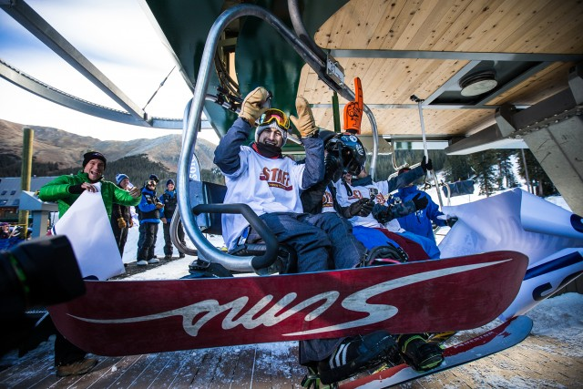 "A snowboarder celebrates ""First Chair"" at Arapahoe Basin's Opening Day in 2016."